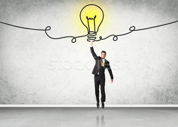 Opknoping zakenman idee lamp hand ruimte Stockfoto © ra2studio