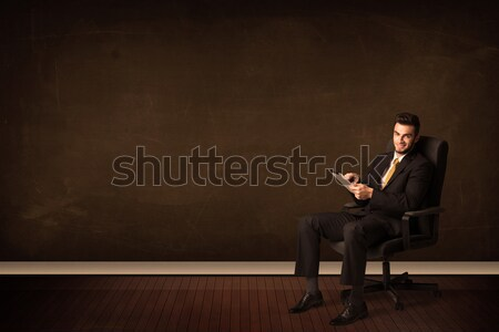 Businessman holding high tech tablet on background with copyspac Stock photo © ra2studio