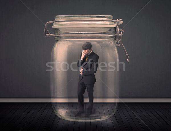 Zakenman gevangen glas jar ruimte financieren Stockfoto © ra2studio