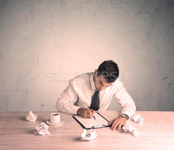 Businessman working at office desk Stock photo © ra2studio