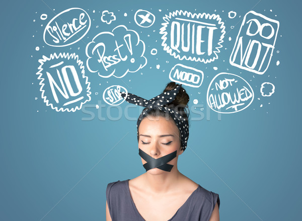 Young woman with glued mouth and thought clouds Stock photo © ra2studio