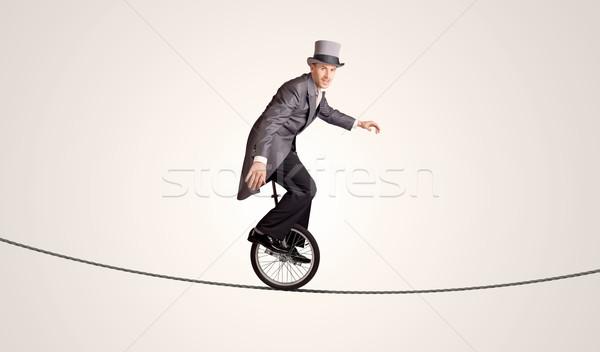 Extremo homem de negócios equitação corda negócio Foto stock © ra2studio