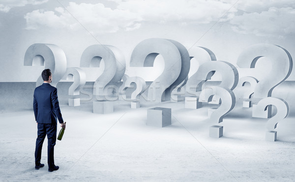Man with  lot of question mark signs and icons Stock photo © ra2studio