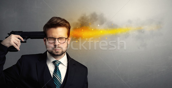 Gone businessman shooting his head with gun Stock photo © ra2studio