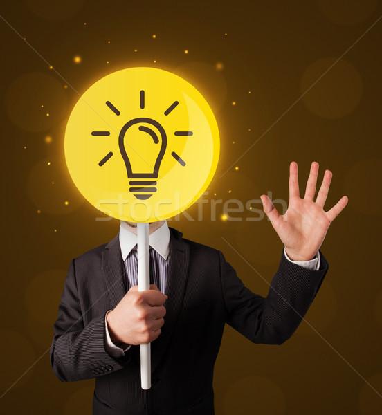 Сток-фото: бизнесмен · лампочка · знак · Smart · желтый