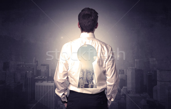 Businessman standing with keyhole on his back Stock photo © ra2studio
