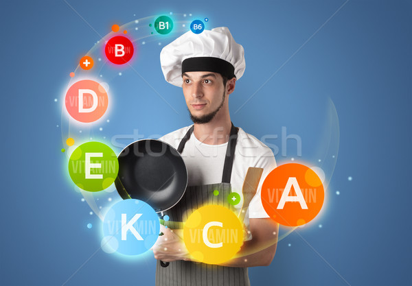 Handsome cook with vitamin concept Stock photo © ra2studio