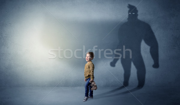 Cute kid with hero shadow behind Stock photo © ra2studio