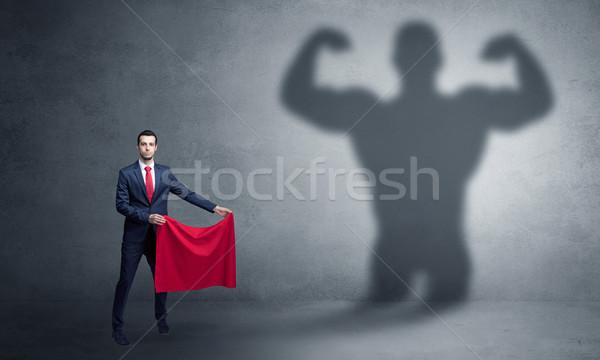 Imprenditore forte eroe ombra piedi rosso Foto d'archivio © ra2studio