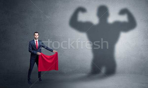 Businessman with strong hero shadow and toreador concept Stock photo © ra2studio