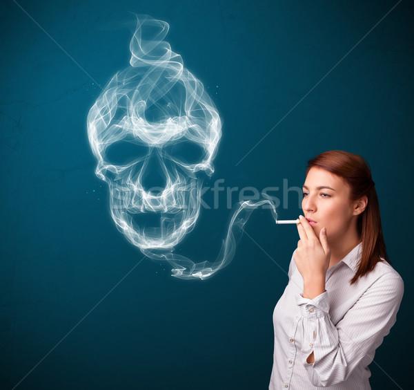 Fiatal nő dohányzás veszélyes cigaretta mérgező koponya Stock fotó © ra2studio