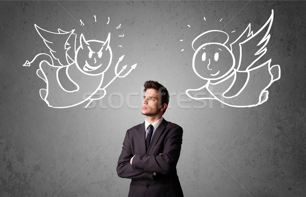 Businessman standing between the angel and the devil Stock photo © ra2studio