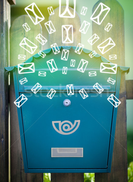 Mailbox with letter icons on glowing green background Stock photo © ra2studio