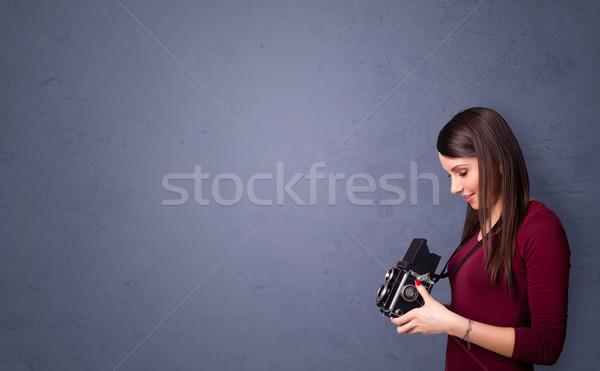 Photographer shooting images with copyspace area Stock photo © ra2studio