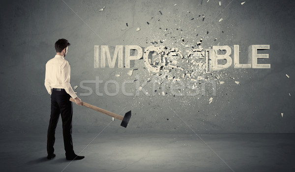 Business man hitting impossible sign with hammer Stock photo © ra2studio