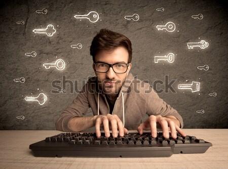 Hacker nerd guy with drawn password keys Stock photo © ra2studio