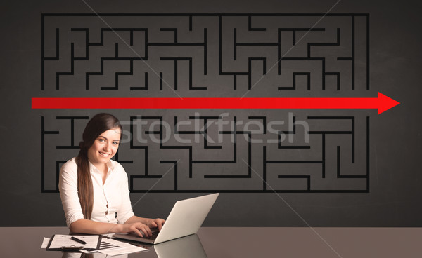 businesswoman with a solved puzzle in background Stock photo © ra2studio