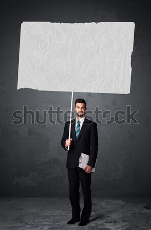 Businessman with blank booklet paper Stock photo © ra2studio
