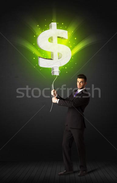 Zakenman dollarteken ballon groene Stockfoto © ra2studio