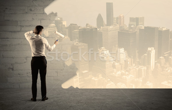 Salesman painting city scape on wall Stock photo © ra2studio