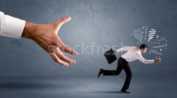 Estresante empresario ejecutando grande mano oficina Foto stock © ra2studio
