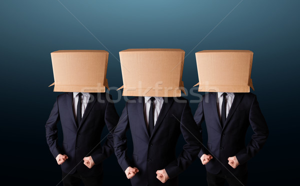 People gesturing with empty box on their head Stock photo © ra2studio