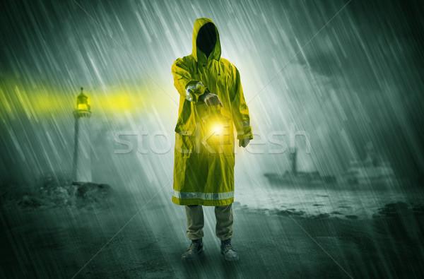Homme lanterne côte imperméable hiver Photo stock © ra2studio