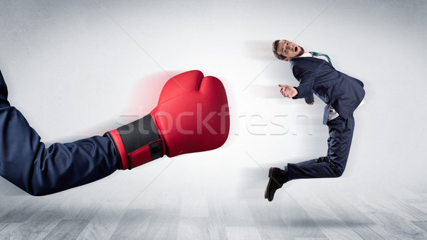Red boxing glove knocks out little businessman Stock photo © ra2studio