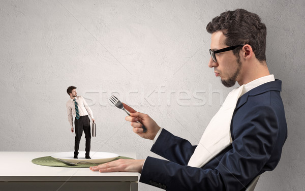 Small scared businessman almost devoured Stock photo © ra2studio
