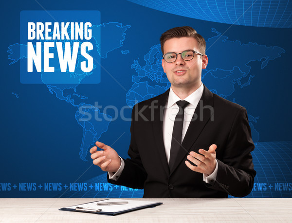 Television presenter in front telling breaking news with blue modern background Stock photo © ra2studio