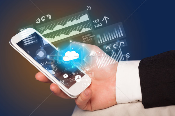 Hand using phone with uploading reports and graphs concept Stock photo © ra2studio