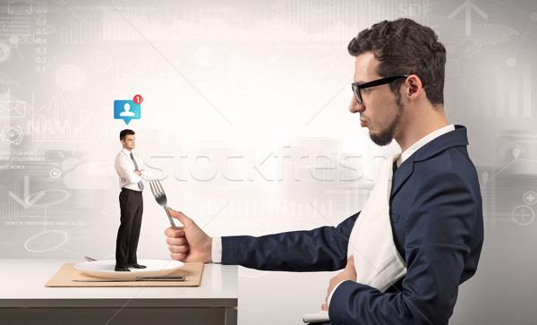 Nagy üzletember eszik kicsi férfi óriás Stock fotó © ra2studio