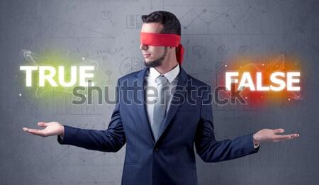 Businessman with devil shadow and toreador concept Stock photo © ra2studio