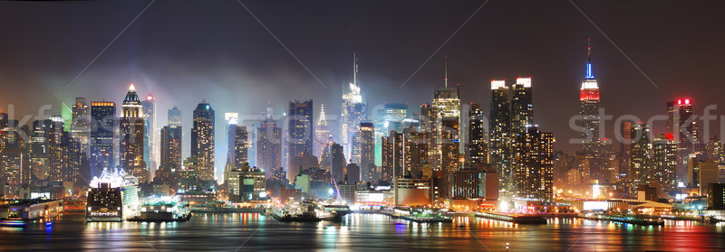 New York City Manhattan skyline panorama at night over Hudson River with refelctions viewed from New Stock photo © rabbit75_sto
