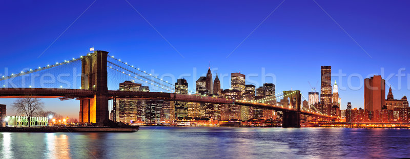 Stock photo: Brooklyn bridge with New York City Manhattan downtown skyline panorama at dusk illuminated over East