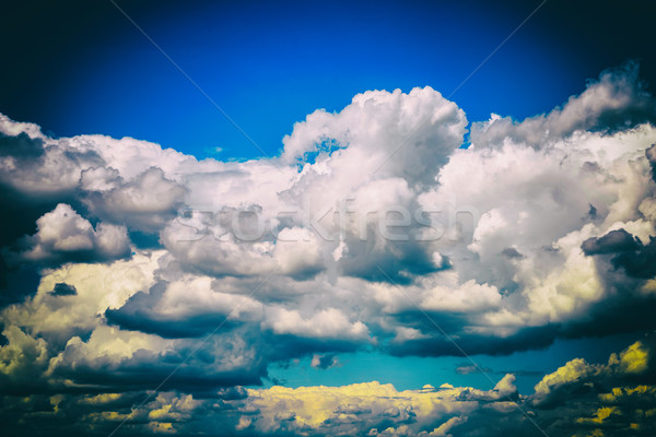 White Cumulus Clouds And Grey Storm Clouds Gathering On Blue Sky Stock photo © radub85