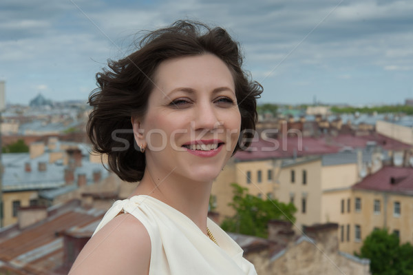 young woman smiling in the wind Stock fotó © raduga21