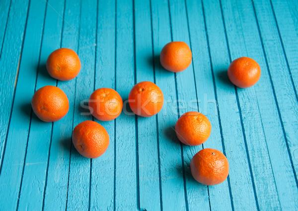 Tabeli wiele mandarynka kłamać niebieski Zdjęcia stock © raduga21