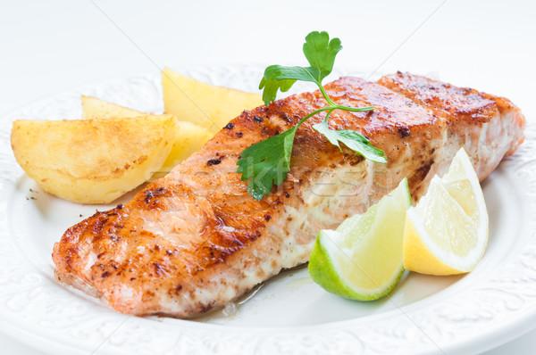 Saumon pommes de terre grillés citron persil alimentaire Photo stock © rafalstachura