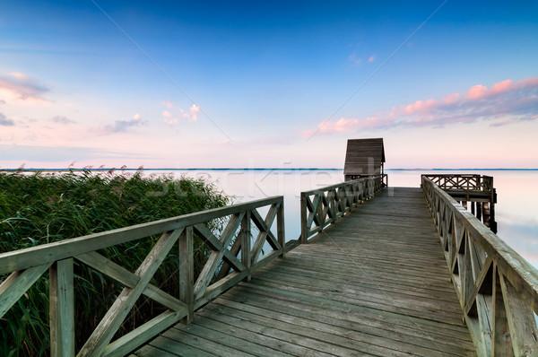 Fából készült móló higgadt tó naplemente színes Stock fotó © rafalstachura