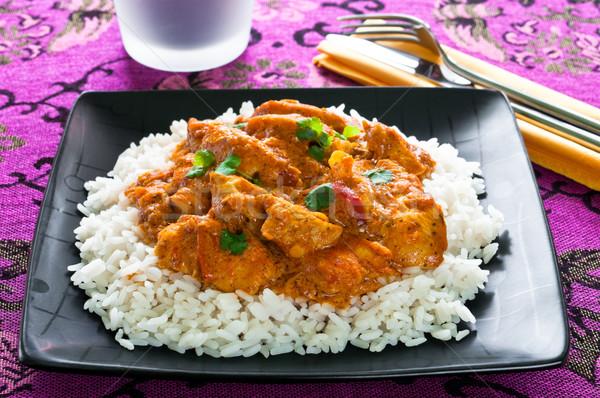 Caril de frango arroz preto prato vermelho carne Foto stock © rafalstachura