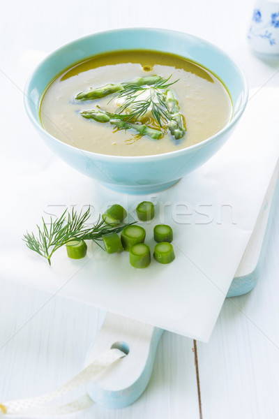 Asparagus soup in a bowl topped with fresh cream, dill and chive Stock photo © rafalstachura