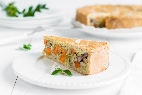 Meat-pie with carrots, red beans and peas on white plate Stock photo © rafalstachura