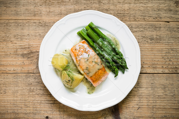 Stock photo: Grilled salmon with boiled potatoes and asparagus. Top view