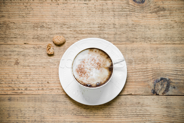 Cup of cappuccino with biscotti on woode table Stock photo © rafalstachura