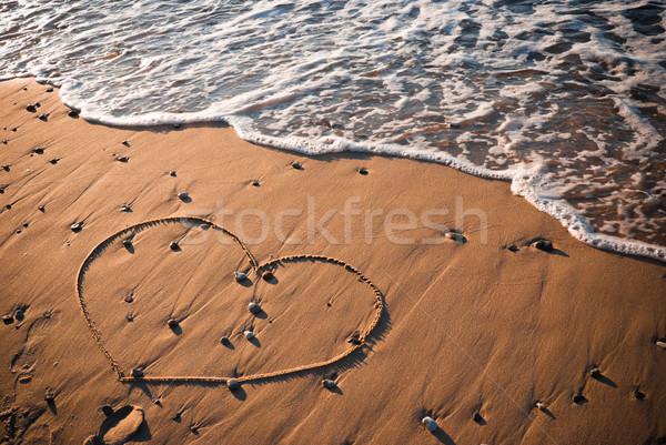 Cuore a forma di cuore scritto sabbia acqua amore Foto d'archivio © rafalstachura