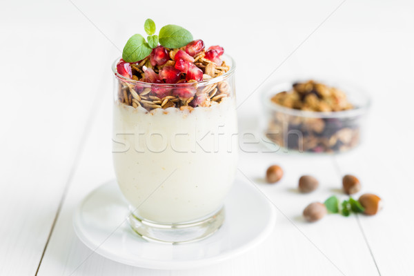 Fresh granola with vanilla cream with pomegranate and mint Stock photo © rafalstachura