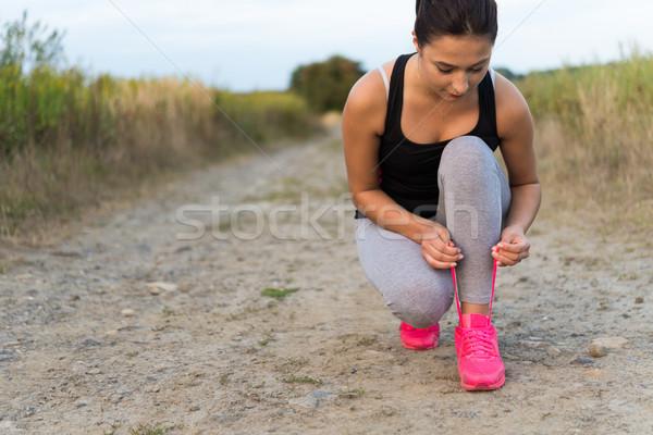 Fiatal sportos nő cipő kint női Stock fotó © rafalstachura