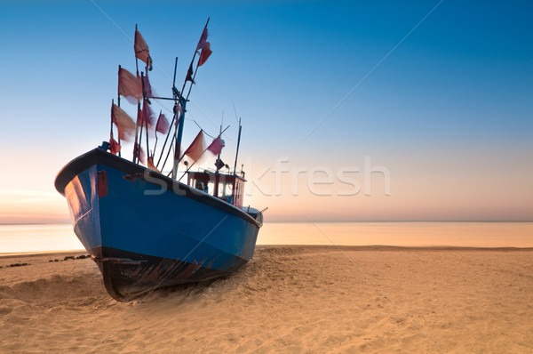 Old fishing boat on the Baltic Sea coast Stock photo © rafalstachura