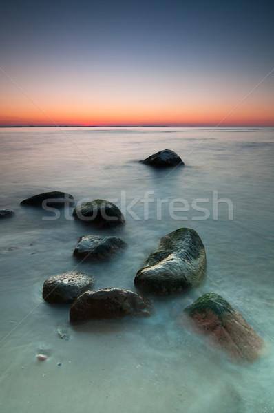Stockfoto: Zeegezicht · zonsondergang · schilderachtig · oostzee · stenen